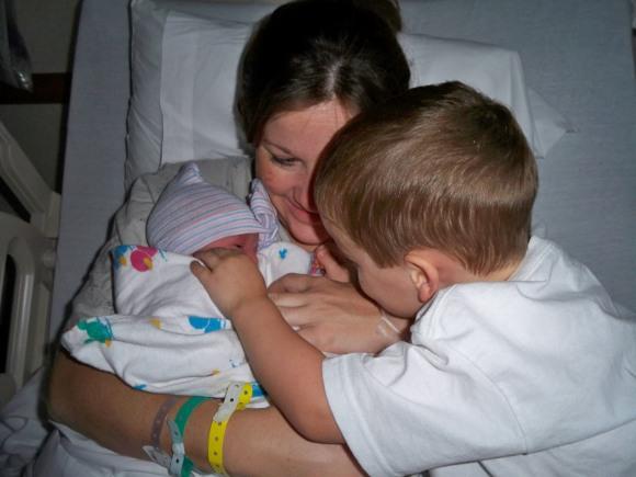 Big bro and little sis with mom